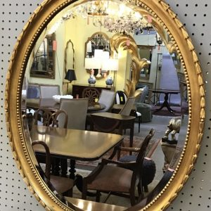 Anna's Mostly Mahogany Consignment - Oval Gilt Mirror